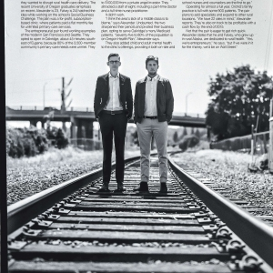 Oliver Alexander and Orion Falvey standing on railroad track for environmental portrait