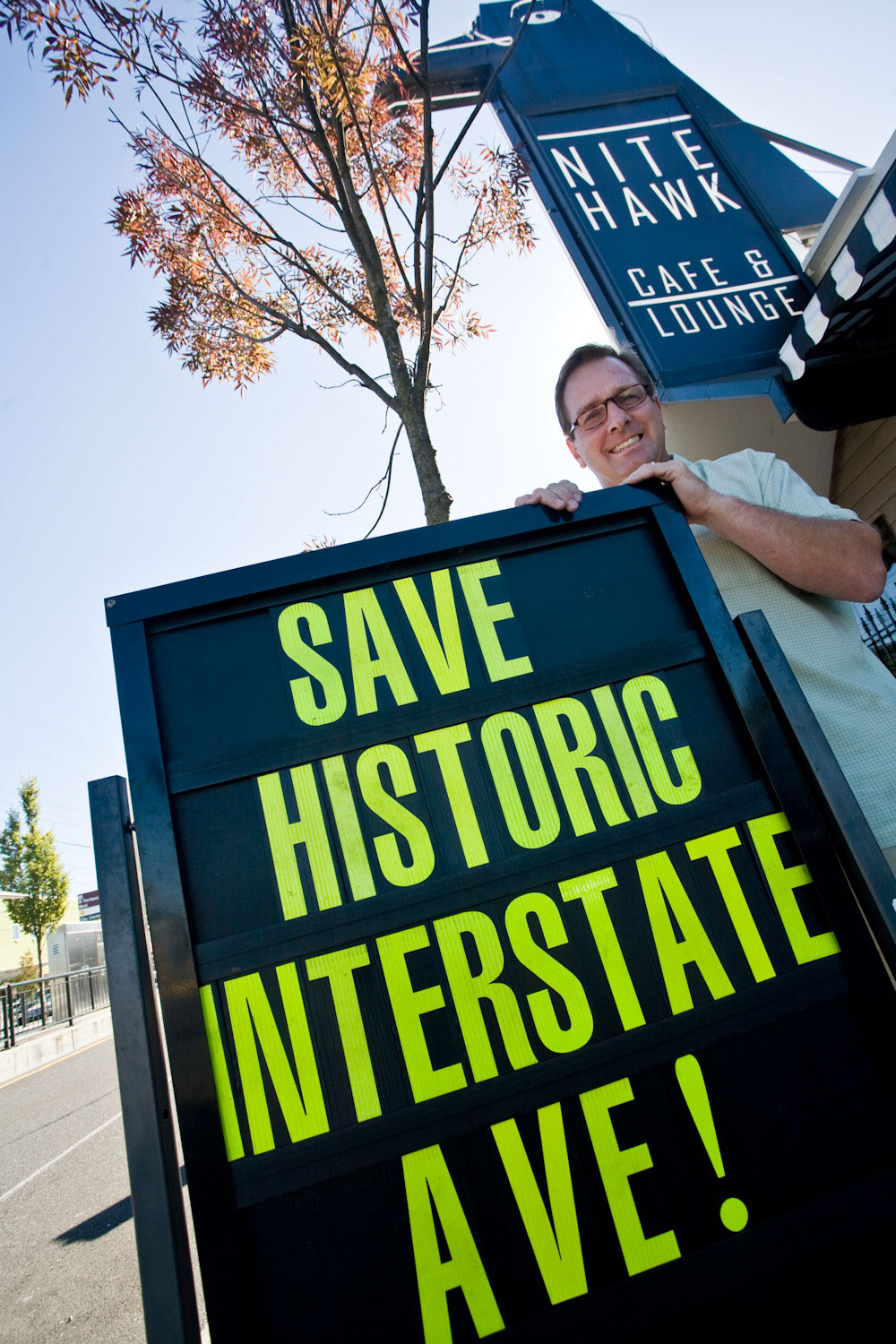 Bill Mildenberger Jr. Manager of the Nite Hawk Cafe with Save Historic Intersate AVE sign