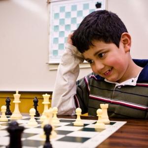 Brayan Moreno-Loa sits chess board scratching his head