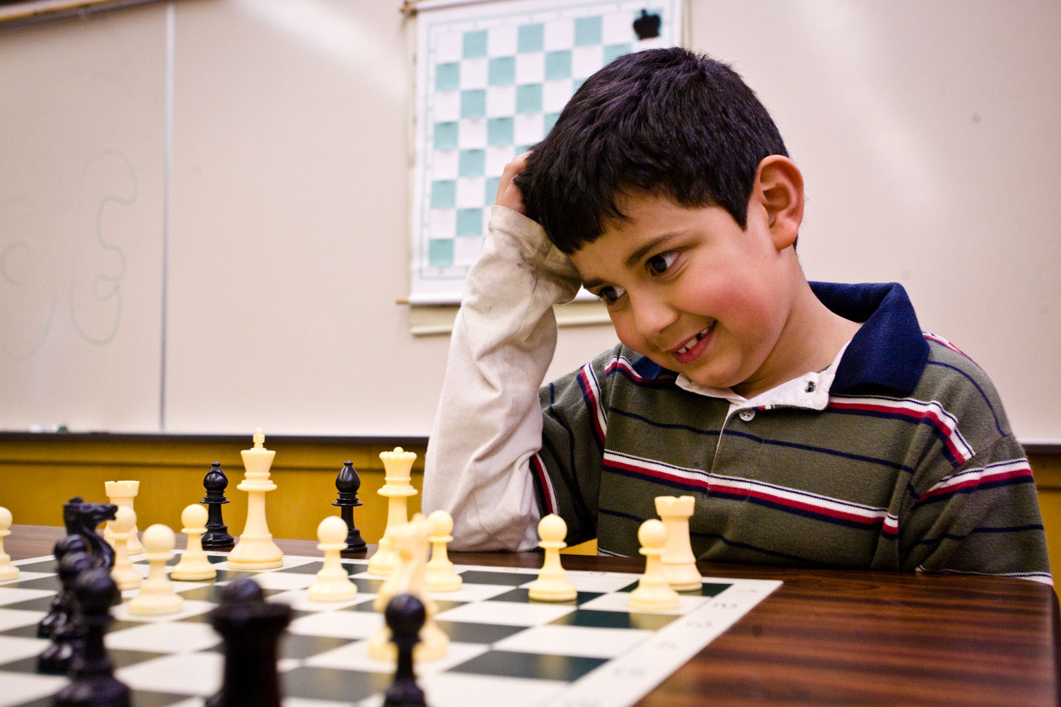 Brayan Moreno-Loa sits chess board scratching his head
