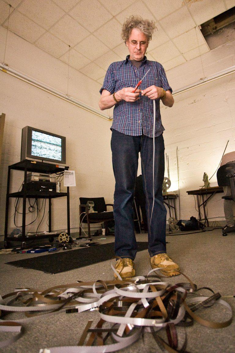 Avantgarde Film Maker Craig Baldwin clips film