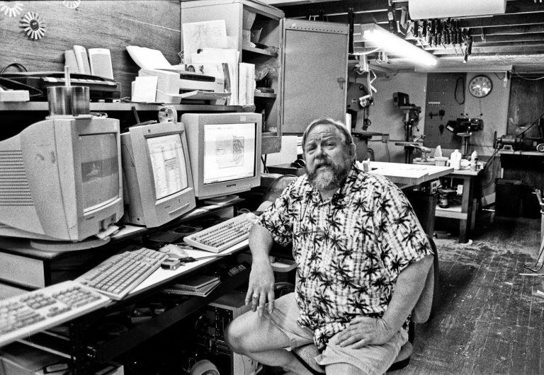 Bridge City Systems - a computer store/wood shop man sitting at desk