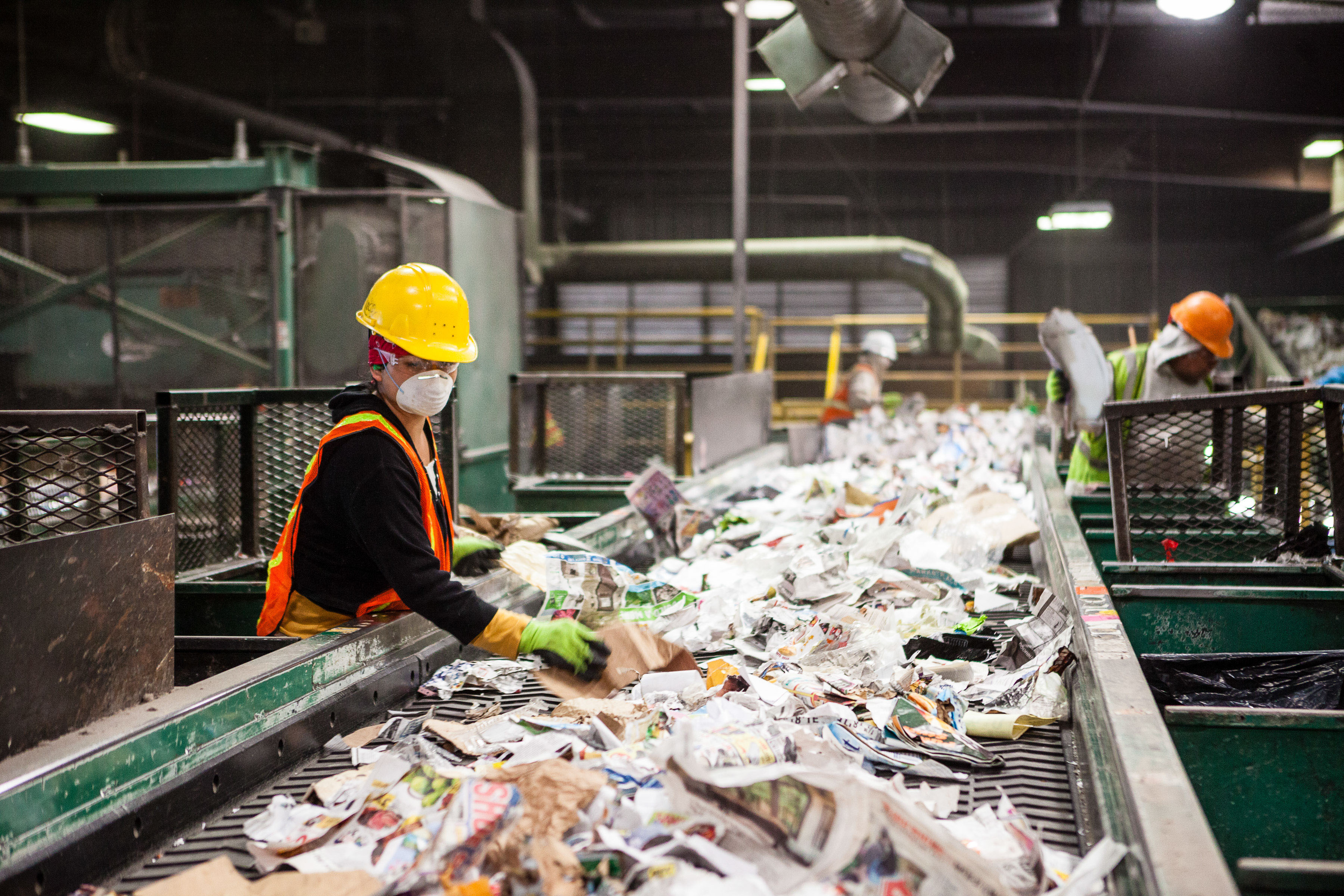 Employees at Farwest Fibers at work sorting paper