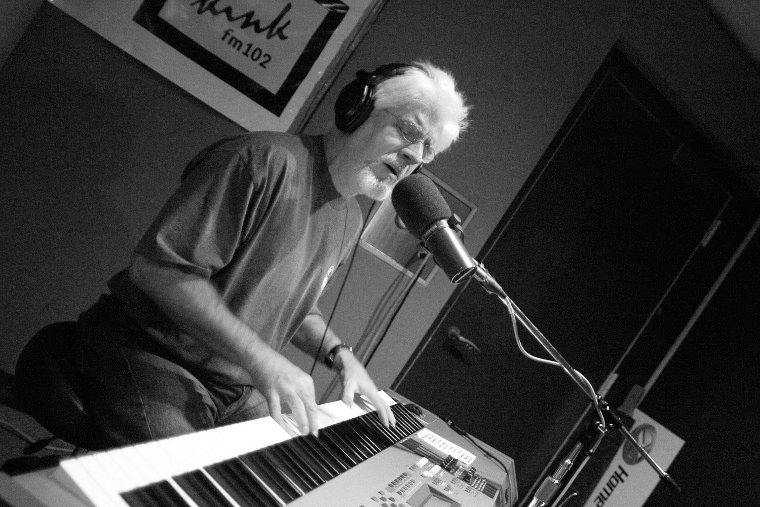 Michael McDonald sings in the sound studio at KINK fm 101.9.