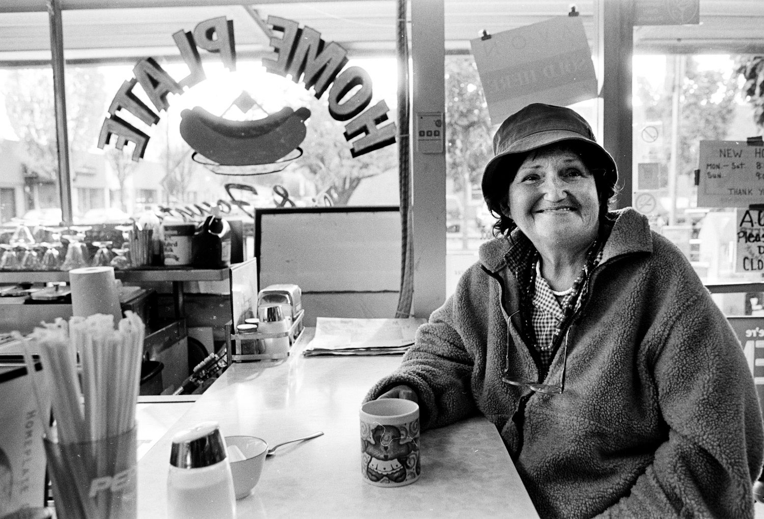 patties-homplate cafe women smiles and drinks coffee