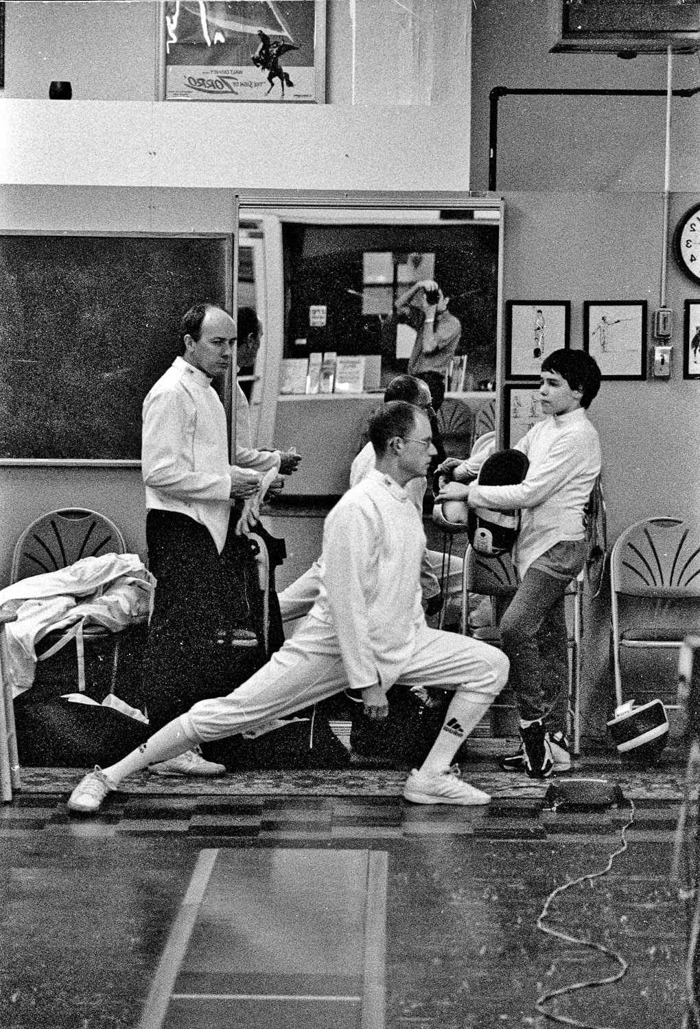 St. Johns Fencing Club member stretches