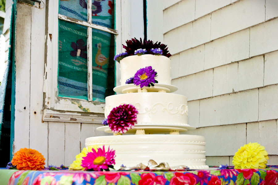 beautiful wedding cake decorated with bright flowers.jpg