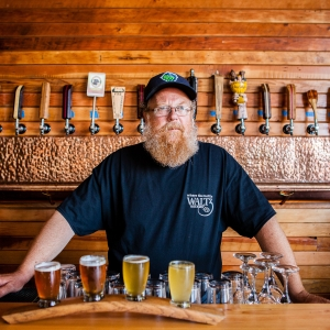 Beer brewer standing behind bar in Oregon