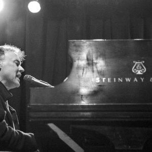 Bruce Hornsby at the piano singing on stag