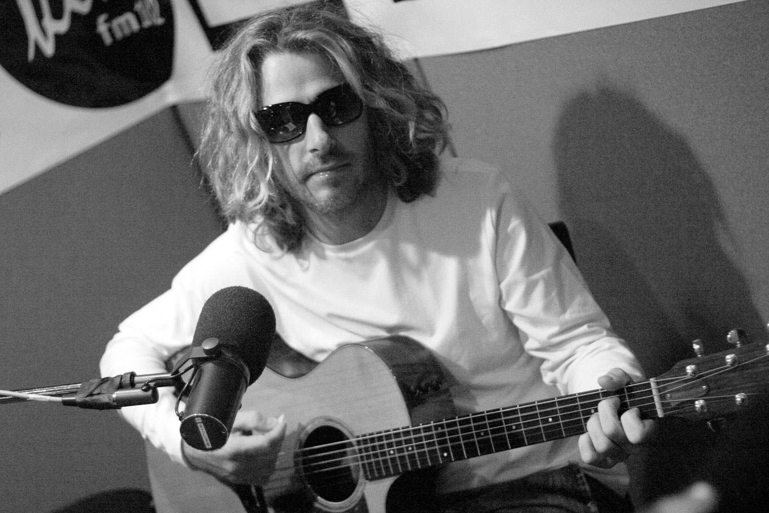 Collective Soul Vocalist Ed Roland plays in the studio of portland radio station.