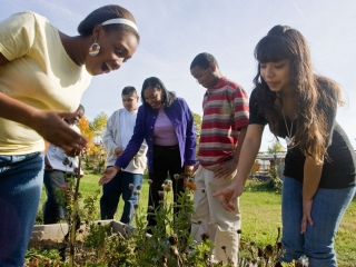 Humboldt Principal Jamila Williams with Students in garden