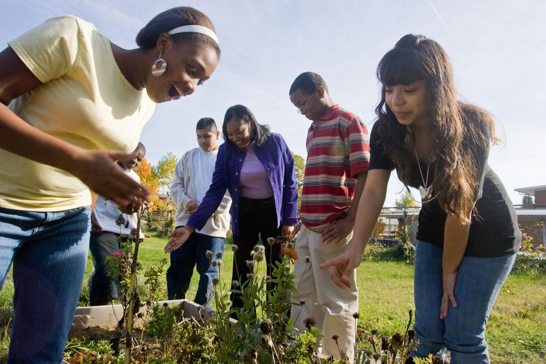 Humboldt Principal Jamila Williams with Students in garden