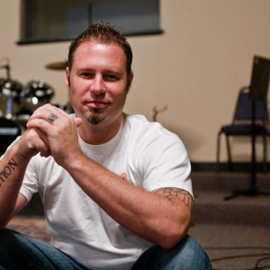 Paster Shaun of Red Sea Church sits in front stage in St. Johns